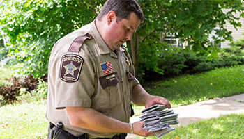 sheriff holding paper